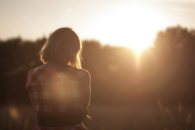 Woman Looking Into Sunset